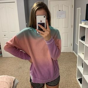 blue, pink, and purple Hollister crew neck